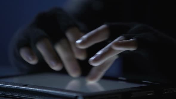 Thumbnail for Closeup of Criminal's Hands Scrolling Pages on Tablet Touchscreen, Cybercrime