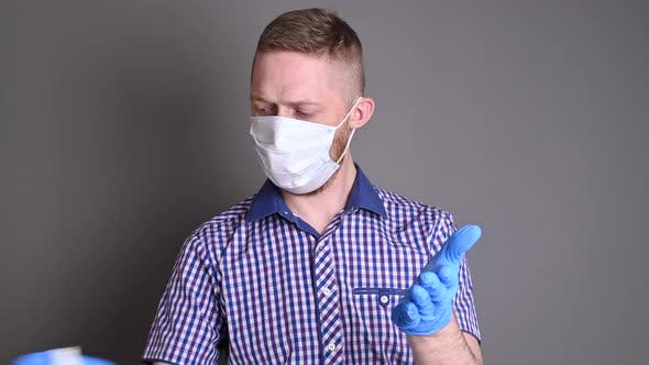 A Man Disinfects Gloves in His Hands. Virus Control and Safety. Spread Covid-19