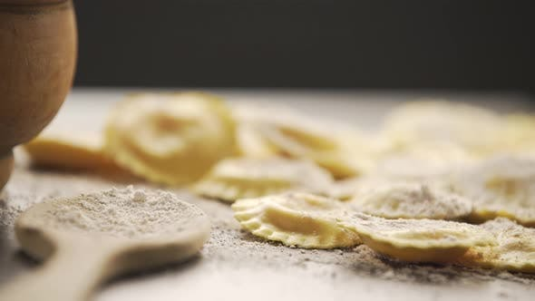 Thumbnail for Cooking italian ravioli on wooden table.