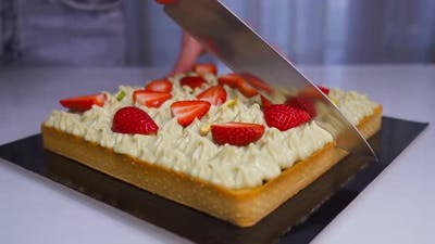 Cake is Cut in Two with the Knife