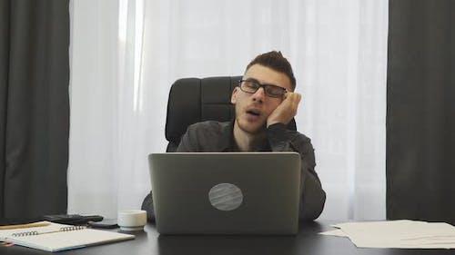 Male broker sleeping at workplace.