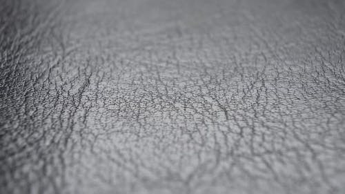 Leather black material texture Wrinkled Abstract natural pattern. Gray upholstery fabric. Macro sho