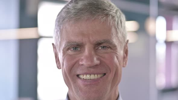 Thumbnail for Close Up of Cheerful Middle Aged Man Smiling at Camera