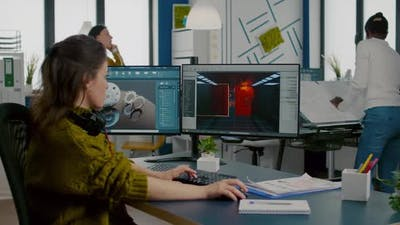 Engineer Analysing Cad Software to Develop Video Game