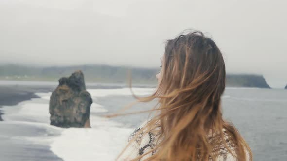 Thumbnail for Beautiful Sad Woman Thinking on the Black Beach in Iceland, Troll Toes Rocks and Wave on the