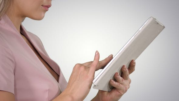 Cover Image for Female hands using tablet on gradient background.