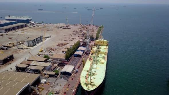 Cover Image for Aerial view Logistics Concept a Cargo Ship Being Retrofit