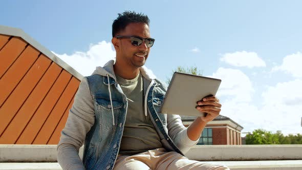 Thumbnail for Man with Tablet Pc Drinking Coffee on Roof Top