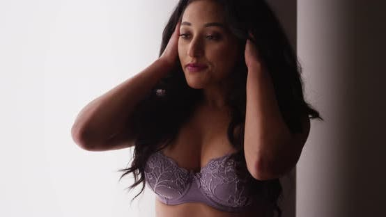 Thumbnail for Sultry Mexican woman standing in lingerie by window