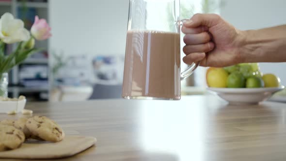 Thumbnail for Taking And Putting Back Jug Of Chocolate Milk
