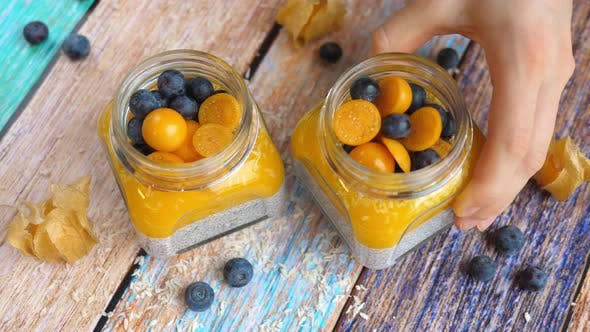 Thumbnail for Chia Seed Vegan Pudding With Mango, Physalis And Blueberry.