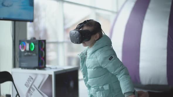 Child Plays Virtual Reality Games