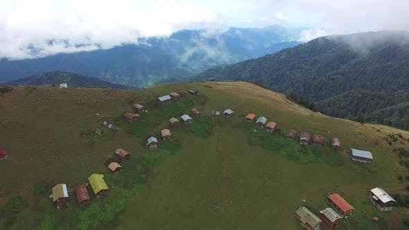 Thumbnail for Little Plateau Houses In The Meadow Above Top Of The Hill