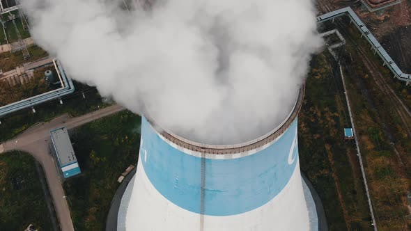 Thumbnail for White Steam Flows Up Over Huge Cooling Tower Upper View
