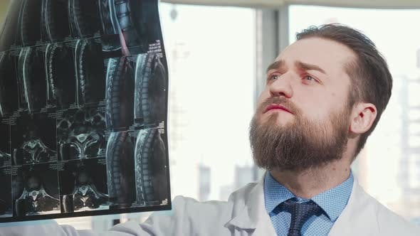 Thumbnail for Bearded Male Doctor Examining Mri Scan of His Patient