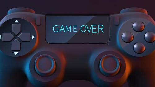 """Game pad with """"game over"""" on the screen."""