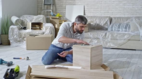 Thumbnail for Man Reading Assembling Manual