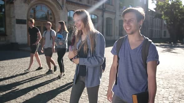 Thumbnail for Two Happy Students Walking on University Campus