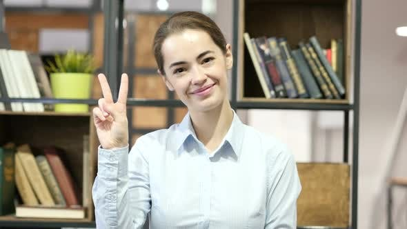 Thumbnail for Woman Showing Victory Sign, Indoor Office
