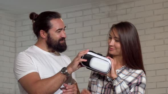 Thumbnail for Cheerful Handsome Mature Man Smiling To the Camera, His Friend Using Vr Glasses