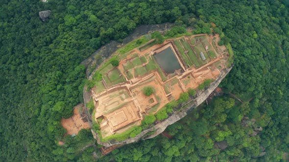 Thumbnail for Aerial View of the Holy Mountain Sigiriya. Circling Around the Mountain Through the Clouds. Mountain