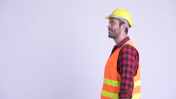 Thumbnail for Profile View of Happy Bearded Persian Man Construction Worker Smiling