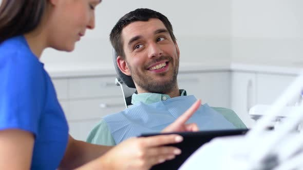 Thumbnail for Dentist and Patient Discussing Dental Treatment 23