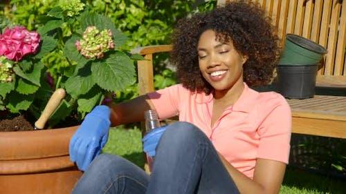 Woman drinking water in garden
