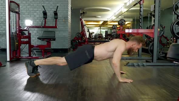Thumbnail for Slow Motion Shot of a Man Doing a Jump Pushup Routine