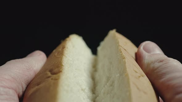 Thumbnail for Man breaking white hot dog bread. Getting ready to cook. Close up.