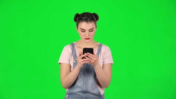 Thumbnail for Girl Angrily Texting on Her Phone on Green Screen