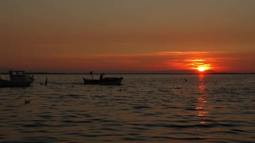 Wooden Fishing Boat Returning From Fishing At Sunset