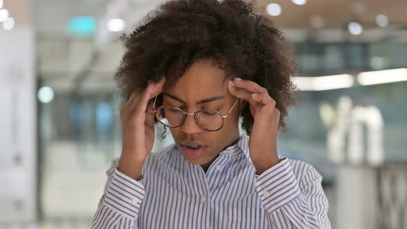 Exhausted African Businesswoman Having Headache