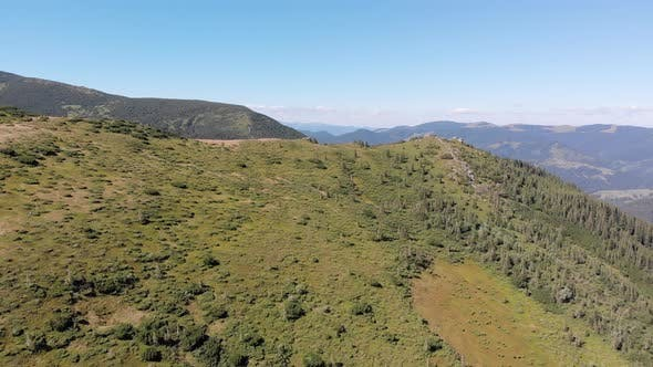 Aerial Panoramic View of Green Mountain Range and Hills in Valley of Carpathian