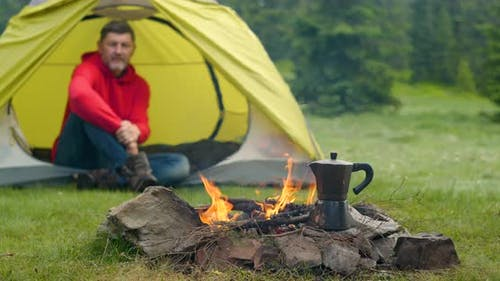 A Coffee Maker By the Fire in a Forest Glade