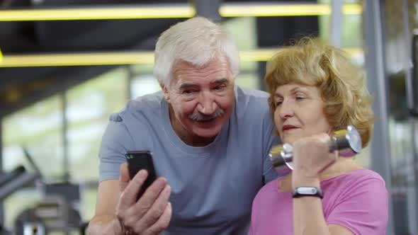Thumbnail for Pensioners with Smartphone in Gym