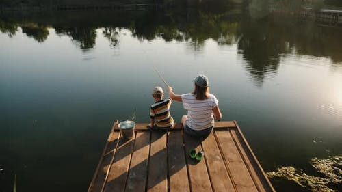 Mom with Her Little Son on a Fishing Trip