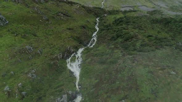 Thumbnail for Aerial View of a Stream in the Valley Behind Clouds