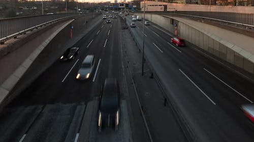 Timelapse of busy city highway in 4k, cars moving on 6 lane motorway