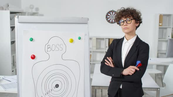 Thumbnail for Curly Company Employee Posing with Darts