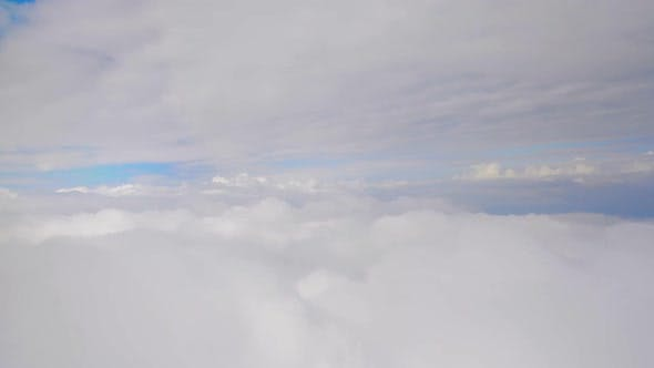 Thumbnail for Layers of thick clouds viewed from airplane, gaining altitude, travelling by air