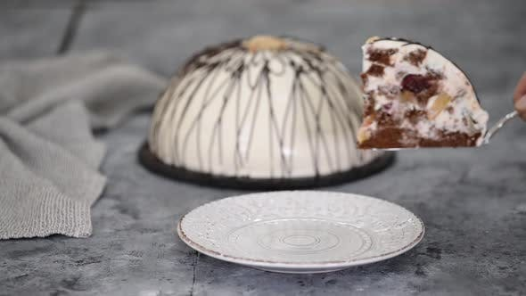 Thumbnail for Piece of Pancho Cake with Pineapple and Sour Cream Topped with Chocolate and Nuts
