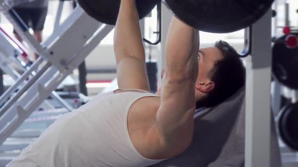 Thumbnail for Handsome Muscular Man Doing Bench Press at the Gym