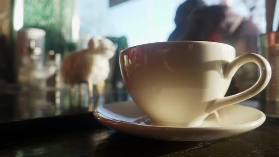 Thumbnail for Tasse Kaffee am Fenster