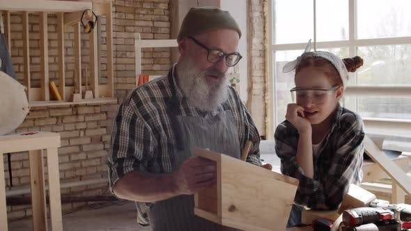 Woodworker with Granddaughter Making Diy