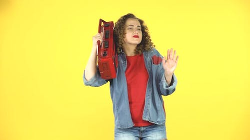 Girl Enjoying the Music and Dancing with the Red Boombox on Her Shoulder, Retro Style