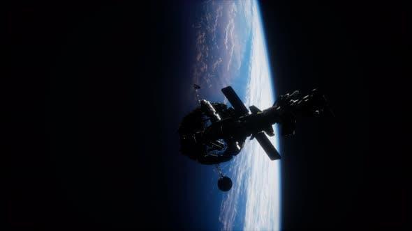 Thumbnail for Illustration 3D d'un vaisseau spatial en orbit autour de la planète Terre
