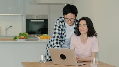 Women Look at Laptop Screen and Discuss News Gossip Video or Movie