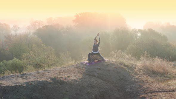 Thumbnail for Yoga Girl Practicing Pilates on Top of the Hill