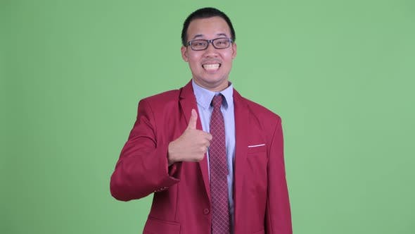 Thumbnail for Happy Asian Businessman with Eyeglasses Giving Thumbs Up